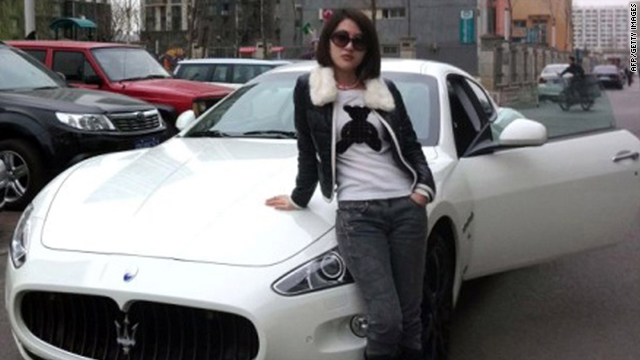 "This photo posted on the internet shows ""Guo Meimei Baby"" in Beijing Tuesday with one of her many cars."