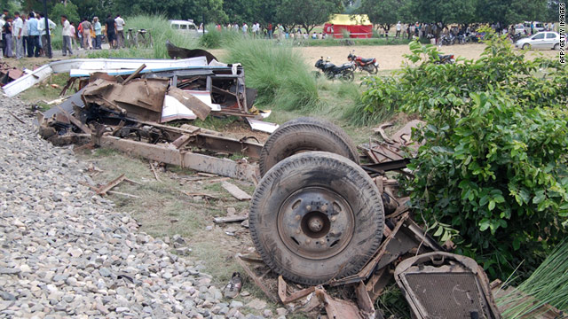 The remains of a bus are seen near train tracks after it was hit by a train in Uttar Pradesh state in northern India.
