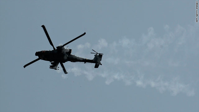An apache attack helicopter fires its machine guns while providing security cover in Afghanistan's Khost province on July 4.