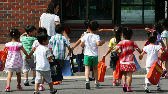 Children, whose parents defected from North Korea, arrive at the Hanawon resettlement facility in South Korea, on July 8, 2009.