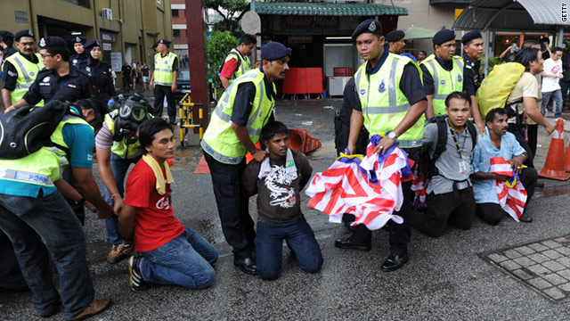 Malaysian police handcuff protesters at a mass rally calling for electoral reform in Kuala Lumpur on July 9.