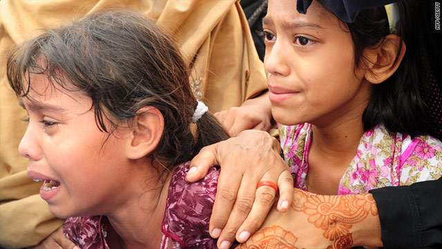 Pakistani children mourn during a funeral procession of a man shot and killed by unidentified armed men in Karachi on July 8.