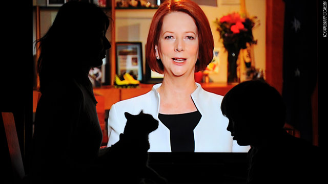 An Australian family watch Prime Minister Julia Gillard's carbon pricing announcement on television.
