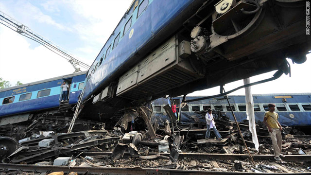 Mangled passenger carriages at the site of a train accident in Fatehpur, 95 miles south of Lucknow, India, on July 10, 2011.