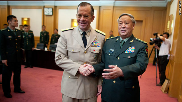 Admiral Mike Mullen shakes hands with China?s General Chen Bingde before their meeting at the Bayi Building on July 11.