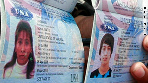 Police show the U.S. passports of Gerfa Yeatts Lunsmann and her son, Kevin, 14, who were kidnapped with a relative.