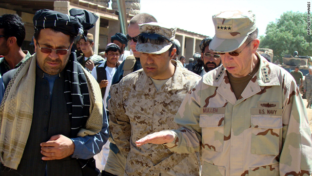 Staff Admiral Mike Mullen gestures as he speaks with Mohammad Gulab Mangal, left, in Marjah on March 30, 2010.