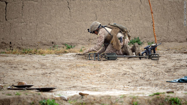A US Marine checks for an IED during a patrol in Helmand Province in March.