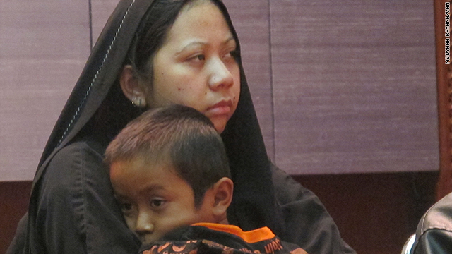Darsem binti Dawud Tawar holds her son on Wednesday at the Indonesian Foreign Ministry in Jakarta.