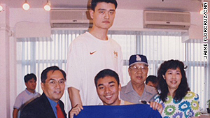 Jaime FlorCruz, left, with Yao Ming and his fans in the Beijing bureau after Yao was drafted into the NBA.