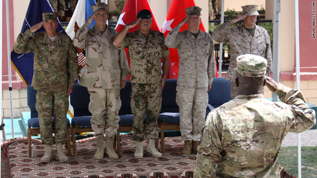 Gen. David Petraeus hands over command of NATO forces to Marine Lt. Gen. John Allen on Monday.