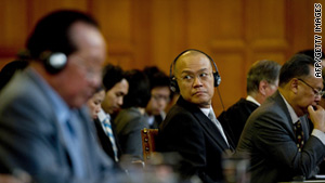 Thailand's Ambassador to the Netherlands Virachai Plasai, center, at the International Court of Justice Monday