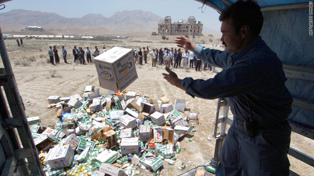 FILE: An Afghan policeman throws a box of beer out of a truck to be destroyed in Kabul, on July 17, 2006.
