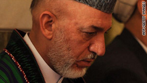 President Hamid Karzai, seen at his half-brother's funeral July 15, condemned the hanging of a boy.