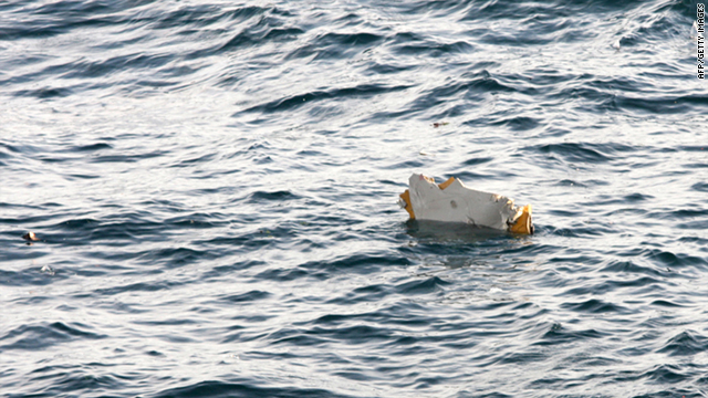 Debris from an Asiana Airlines cargo plane floats 100 kilometres west of South Korea's southern island of Jeju Thursday.