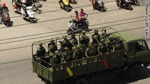 Chinese troops were deployed to patrol the streets of Kashgar, in the restive Xinjiang region in 2009.