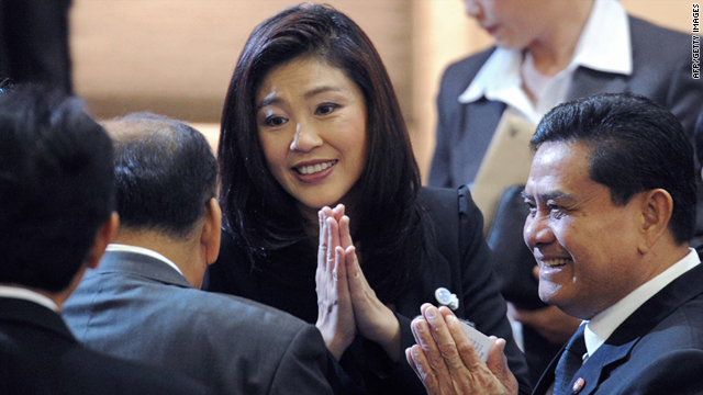 Thai Prime Minister Yingluck Shinawatra (C) gives a traditional greeting to members of parliament in Bangkok, on August 2.