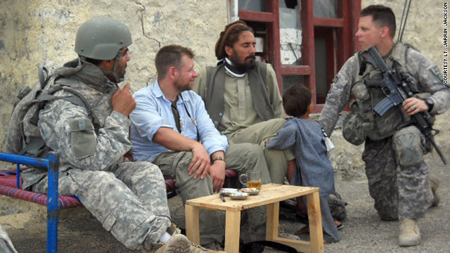Army Lt. Jarrin Jackson, far right, talks with an Afghan civilian in the insurgent-heavy Khost province.