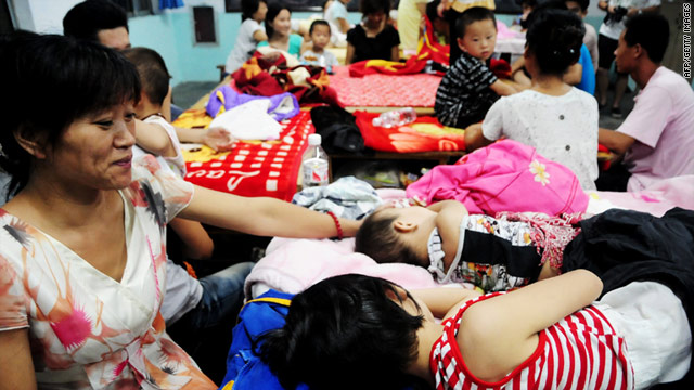 Chinese residents spend a night at a school in China's Shandong province on August 8, 2011.
