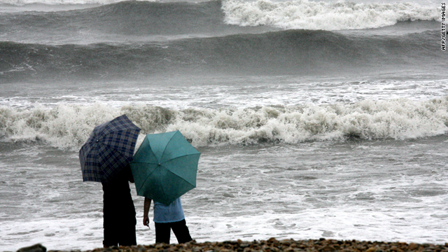 People watch rough seas caused by Tropical Storm Muifa in Dalian, in north China's Liaoning province on Wednesday.