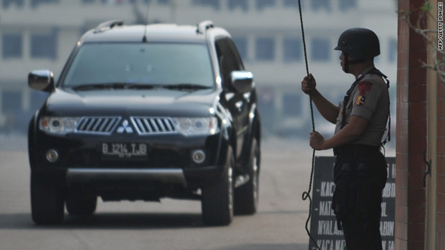 Police guard the gate of the police detention centre in Kelapa Dua where Umar Patek is being held after arriving in Indonesia.