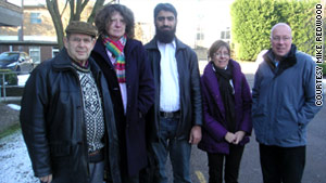 Warren Weinstein, left, is shown in this group photograph.