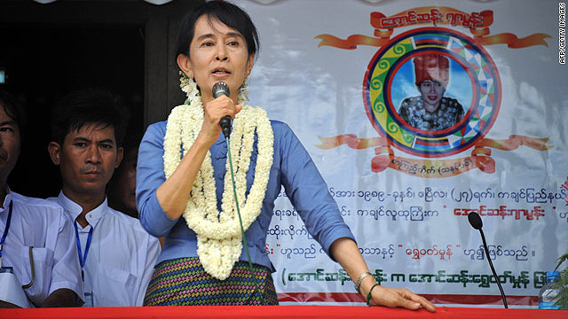 Aung San Suu Kyi talks Sunday during an opening ceremony for a library in Bago, north of Yangon.  