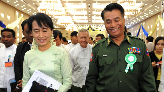 Aung San Suu Kyi talks with Border Affairs Minister, Major General Thein Htay on August 20, 2011.