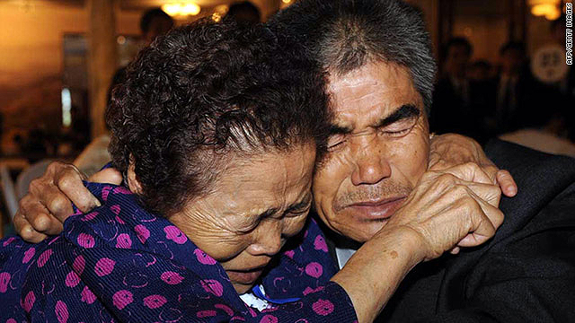 A South Korean mother cries with her North Korean son after meeting at the Mount Kumgang resort, on September 28, 2009.