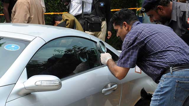 Pakistani police examine the car of the abducted son of slain former Pakistani governor Salman Taseer in Lahore on Friday.