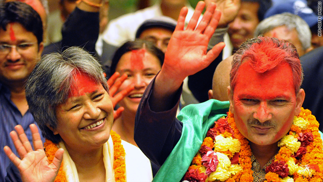 Newly elected prime minister Baburam Bhattarai, right, greets supporters as he leaves the parliament in Kathmandu on Sunday.