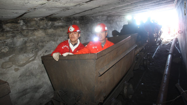 Chinese rescuers prepare to enter the Hengtai coal mine on 24 August, a day after an accident left dozens of miners trapped.
