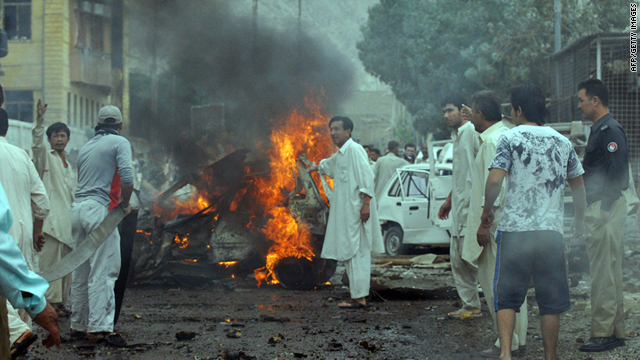 Local residents gather at the site of a car bomb blast in Quetta, Pakistan, on Wednesday.