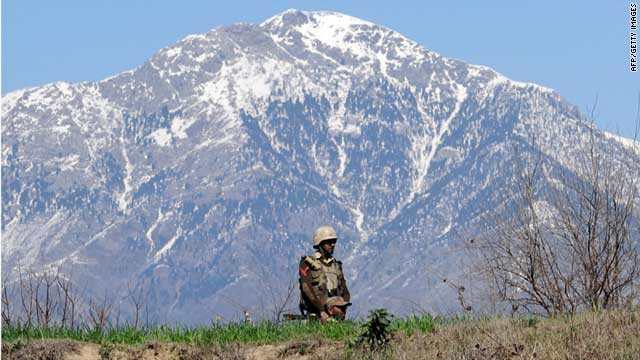 (file photo) Pakistani soldiers patrol in Bajaur Agency, which lies along the border with Afghanistan, in February 2009.