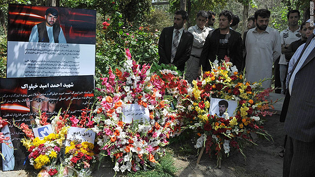 Afghan journalists place wreaths for Ahmad Omid Khpalwak during a memorial gathering in Kabul on August 4, 2011.
