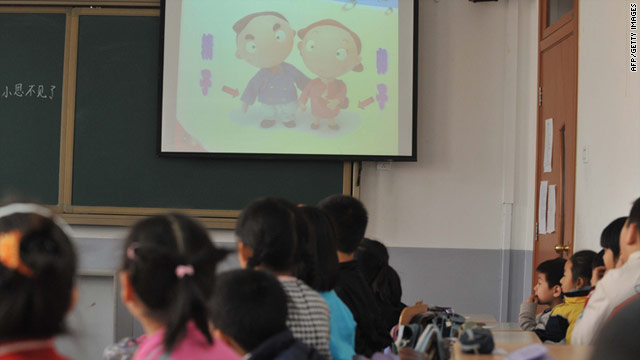 Chinese children attend a sex education class in an elementary school in Beijing on December 9, 2010.