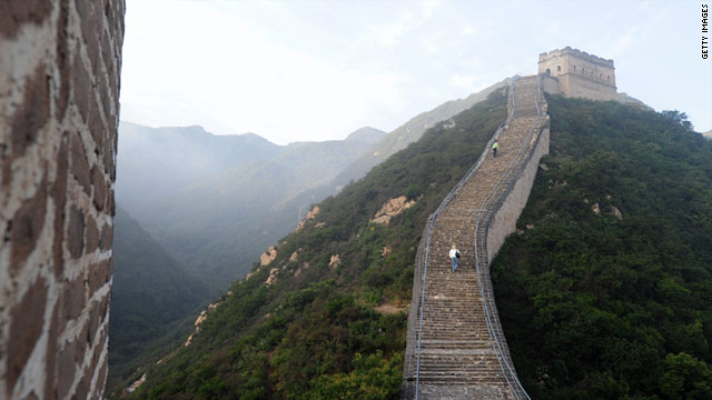 People hike up a remote section of the Great Wall at Badaling, north of Beijing on September 24, 2010.
