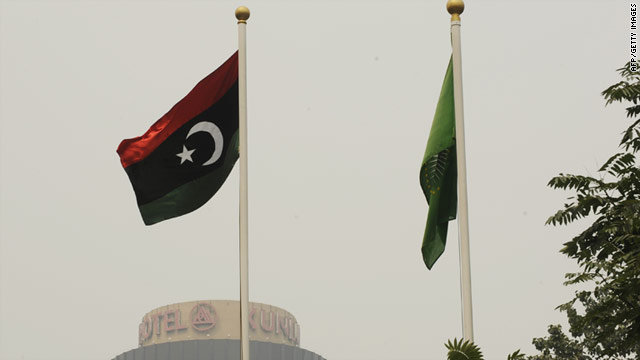 The flag of the Libyan transitional government flies at the Libyan Embassy in Beijing on August 23.