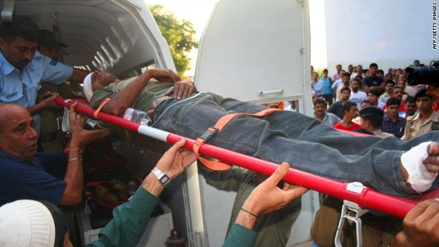 A wounded passenger is moved from an ambulance van to the Government Medical College Hospital in Jammu.