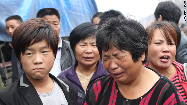 A woman grieves as family members of victims gather after a 30-year-old attacker killed six people with an axe in Henan province's Gongyi city on September 14.