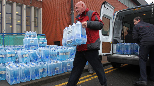 Workers unload bottles of water near Belfast as the crisis continues to affect homes in Northern Ireland.