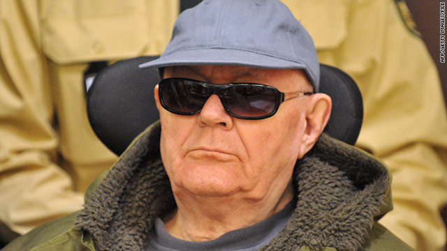 Suspected Nazi war criminal John Demjanjuk, 89, arrives in a wheelchair for a court session in Germany last year.