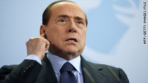 "Italian Prime Minister Silvio Berlusconi says his opponents are throwing ""mud"" in an effort to get rid of him."