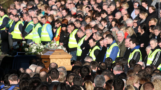 The body of Michaela Harte-McAreavey passes mourners during the funeral