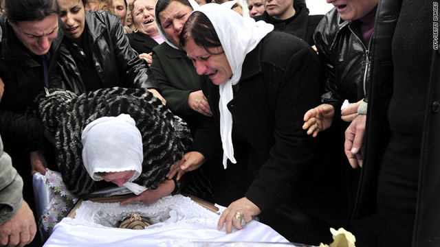Relatives grieve over the body of Herukan Deda, 40, in Laknas on Saturday a day after a deadly riot that killed Deda and two others.