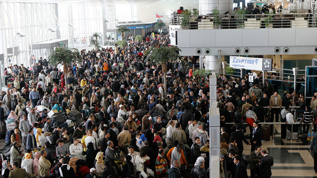 Large crowds looking for flights out of Egypt wait in the halls of Cairo International Airport on February 1, 2011.