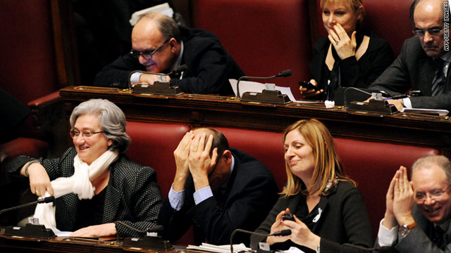Italian Democratic Party members react Thursday after a request by prosecutors to search Silvio Berlusconi's property.