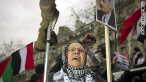 A woman holds a poster with a picture of former Egyptian President Nasser at a protest in Paris on February 5.