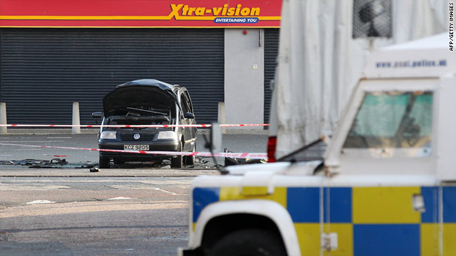 An exploded car sits near a video shop on Antrim road on January 27 after police carried out a controlled explosion.
