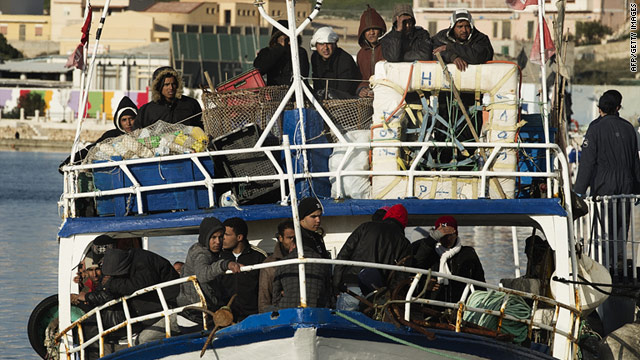 A boat carrying Tunisian immigrants arrives at the Italian island of Lampedusa on Sunday.